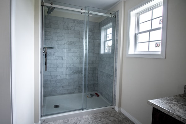 Bathroom with shower, toilet, and sink
